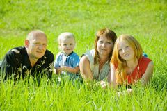Happy family on grass Stock Photos