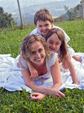 Happy family on the grass 2. A happy family on the garden grass scene Stock Photography