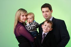 Happy family on a green background Stock Images