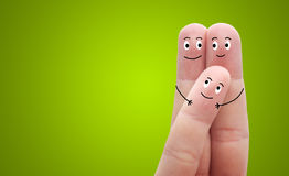 A happy family on green background Royalty Free Stock Photography