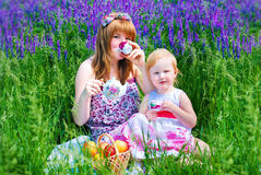 Happy Family in Green Grass take a Teaparty. Royalty Free Stock Image