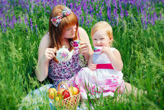 Happy Family in Green Grass take a Teaparty. Royalty Free Stock Photos