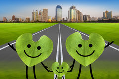 Happy family on the green road with city. environmental protecti Stock Photography