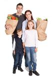 Happy family with grocery shopping bags Royalty Free Stock Images