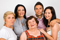 Happy family group. With grandma,mother and three children standing together in embrace and smiling,check also stock images