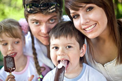 Happy family and group children eat ice cream. Stock Photo