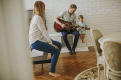 Happy family with guitar. At home stock photo