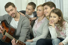 Happy family with guitar  at home Stock Photo