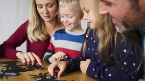 Happy family during Halloween. Handheld video of happy family preparing decoration for Halloween stock footage