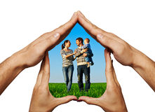 Happy family in the hands home Royalty Free Stock Photo