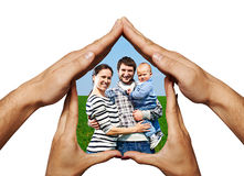 Happy family in hands home Stock Photo