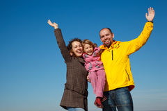 Happy family with the hands lifted upwards royalty free stock image