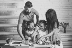 Happy family. Happy childhood and parenting. Finger painting and arts. Imagination, creativity concept. Girls drawing with mother and father. Children playing Stock Image