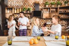 Happy family has fresh orange juice for breakfast stock images