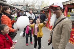 Chinese family has fun with cotton candy beard Stock Photo