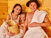 Happy family in hat  at sauna Stock Image