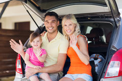 Happy family with hatchback car at home parking Stock Images