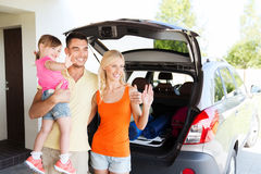 Happy family with hatchback car at home parking Royalty Free Stock Photography