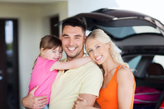 Happy family with hatchback car at home parking Royalty Free Stock Photos