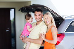Happy family with hatchback car at home parking Royalty Free Stock Photo