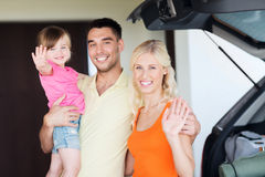 Happy family with hatchback car at home parking Royalty Free Stock Images