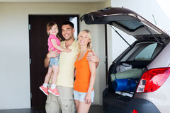 Happy family with hatchback car at home parking Stock Image