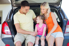 Happy family with hatchback car outdoors Stock Photo