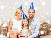 Happy family in hats celebrating Royalty Free Stock Image