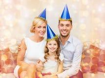 Happy family in hats celebrating Stock Photography