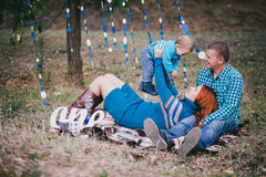 Happy family have birthday party with blue decorations in forest Stock Photos