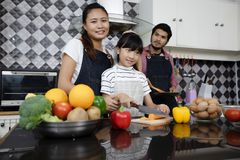 Happy Family have Dad, Mom and their little daughter Cooking Tog royalty free stock image