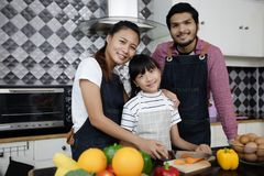 Happy Family have Dad, Mom and their little daughter Cooking Tog royalty free stock images