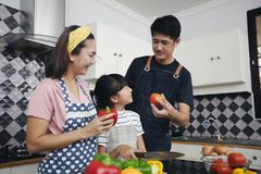 Happy Family have Dad, Mom and their little daughter Cooking Tog stock images