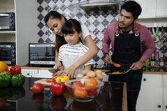 Happy Family have Dad, Mom and their little daughter Cooking Tog stock photo