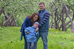 Happy family have fun in apple garden Stock Photo