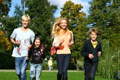Happy family have fun in park Royalty Free Stock Image