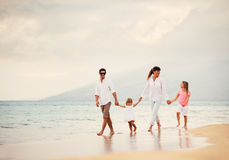 Happy Family have Fun Walking on Beach at Sunset Royalty Free Stock Photography