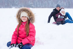 Happy family have fun in winter snowy day Royalty Free Stock Images