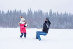 Happy family have fun in winter snowy day Stock Photos