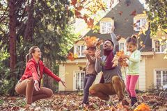 Happy family have play at backyard. Happy young family in nature Royalty Free Stock Photography