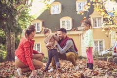 Happy family have play at front of backyard. Family time. Happy family have play at front of backyard Stock Image