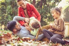 Happy family have playing together. On the move. royalty free stock image
