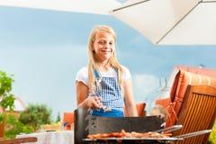 Happy family having a barbecue Stock Photo
