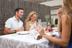 Happy family having barbecue Stock Images