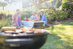 Happy family having barbecue in the park. Portrait of happy family having barbecue in the park Stock Photos