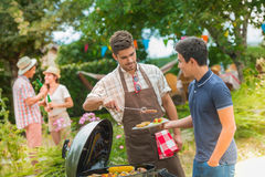 Happy family having barbecue on sunny day Royalty Free Stock Image