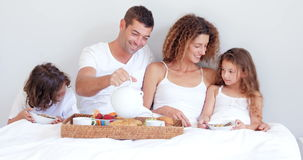 Happy family having breakfast stock footage