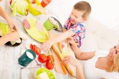 Happy family having breakfast at home Stock Photos