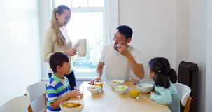 Happy family having breakfast. At home stock footage