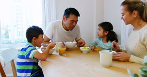 Happy family having breakfast. At home stock video footage